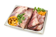 Raw meat. On the steel tray Royalty Free Stock Image