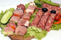 Raw meat. On wooden plate decorated with vegetables Stock Photo