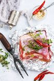 Raw meat in foil. Raw meat with aroma spice and salt, stock photo Royalty Free Stock Photography