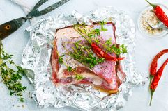 Raw meat in foil. Raw meat with aroma spice and salt, stock photo Stock Photo