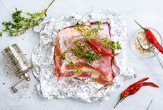 Raw meat in foil. Raw meat with aroma spice and salt, stock photo Stock Images