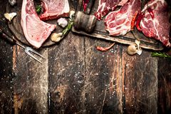 Raw meat background. Raw pork chop with a variety of herbs and spices. Stock Image