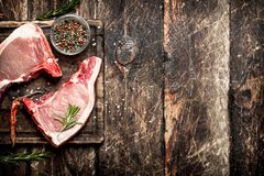 Raw meat background. Raw pork with spices . On the old wooden table Stock Image