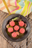 Raw meat balls in a brass pan Stock Image
