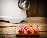 Raw meat balls on a chopping board. Royalty Free Stock Photo