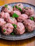 Raw meat balls. Prepared uncooked meat balls in a metal tray. Tr Royalty Free Stock Photo