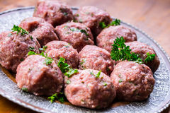 Raw meat balls. Prepared uncooked meat balls in a metal tray. Tr Royalty Free Stock Images