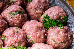 Raw meat balls. Prepared uncooked meat balls in a metal tray. Tr Stock Image