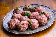 Raw meat balls. Prepared uncooked meat balls in a metal tray. Tr Royalty Free Stock Photography