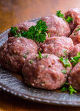 Raw meat balls. Prepared uncooked meat balls in a metal tray. Tr Stock Photos