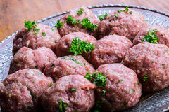 Raw meat balls. Prepared uncooked meat balls in a metal tray.  Stock Photography