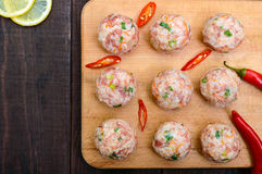Raw meat balls, ready for cooking on a cutting board. Royalty Free Stock Images