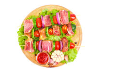 Raw meat barbecue with vegetables, spices and herbs Royalty Free Stock Image