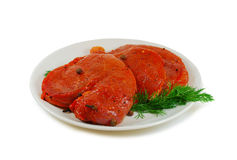 Raw meat. Beef escalope slices with sause in a Dish Isolated Against White Background Royalty Free Stock Image