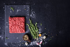 Raw meat, beef steak on black background, top view,. Copy space Royalty Free Stock Image