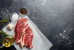 Raw meat, beef steak on black background, top view, free space stock photography