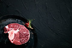 Raw meat. Meat. Raw meat beef steak on black with herbs Royalty Free Stock Images