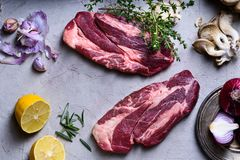 Raw meat, beef steak with cooking ingredients, spices,. Top view Stock Photo