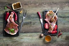 Raw meat, beef steak. Raw meat with herbs, honey and spices on old wooden background. Raw pork steak. Ingredients for cooking meat flat lay copy space Stock Photo