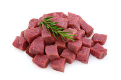 Raw meat, beef steak sliced in cubes. Isolated on white background Stock Image
