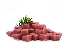 Raw meat, beef steak sliced in cubes. Isolated on white background Royalty Free Stock Images