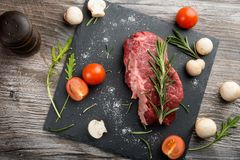Raw meat, beef steak with spices. And herbs Royalty Free Stock Photography