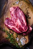 Raw meat, beef steak on wooden cutboard,spices, top view. Raw meat, beef steak on wooden cutboard, spices, top view Stock Photography