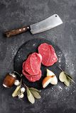 Raw meat, beef steaks. On black background Stock Photos