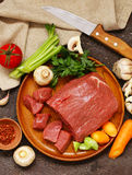 Raw meat beef. On a wooden board Stock Images