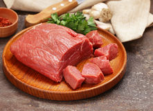 Raw meat beef. On a wooden board Stock Photos