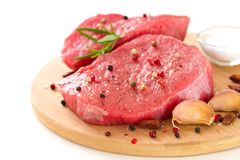Raw meat with black pepper, garlic Royalty Free Stock Photos