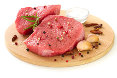 Raw meat with black pepper, garlic and salt Stock Photography