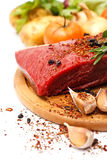 Raw meat on board Stock Images
