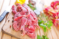 Raw meat. On the board Stock Photography