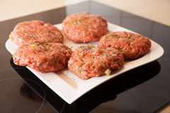 Raw meat burger lies on a plate. Meat burger lies on a plate Royalty Free Stock Photography