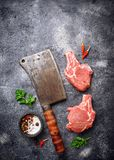 Raw meat and butchers knife. Top view Stock Images