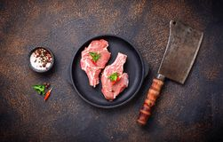 Raw meat and butchers knife. Top view Stock Photo