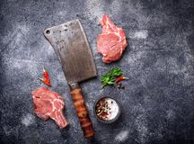 Raw meat and butchers knife. Top view Royalty Free Stock Photo