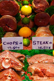 Raw meat in a butchers shop Royalty Free Stock Images