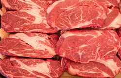 Raw meat. Chopped steaks from marbled beef with large layers of fat. Pieces lie horizontally. Raw meat. Chopped steaks from marbled veal with large layers of fat stock photos