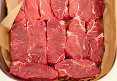 Raw meat. Chopped steaks from marbled beef on pallet with napkin. Raw meat. Chopped steaks from marbled veal on a pallet with napkin. Background for work Royalty Free Stock Photography