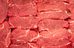 Raw meat. Chopped steaks from marbled beef with thin layers of fat. Pieces lie horizontally. Raw meat. Chopped steaks from marbled veal with thin layers of fat Royalty Free Stock Image
