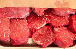 Raw meat. Chopped steaks medallions of marbled veal on a pallet. Raw fresh meat. Chopped steaks medallions of marbled veal on a pallet Royalty Free Stock Photo