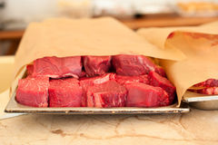 Raw meat. Chopped steaks medallions of marbled veal on a pallet. Raw fresh meat. Chopped steaks medallions of marbled veal on a pallet Royalty Free Stock Images