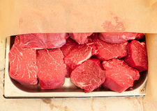 Raw meat. Chopped steaks medallions of marbled veal on a pallet. Raw fresh meat. Chopped steaks medallions of marbled veal on a pallet Stock Image