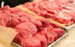Raw meat. Chopped steaks medallions of marbled veal on a pallet. Raw fresh meat. Chopped steaks medallions of marbled veal on a pallet Stock Photography