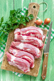 Raw meat. On a chopping board Royalty Free Stock Photography