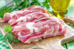 Raw meat. On a chopping board Royalty Free Stock Photos