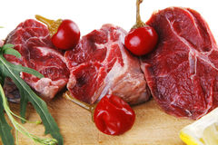 Raw meat chunk on wood Royalty Free Stock Images