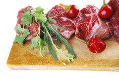 Raw meat chunk on wood Stock Image